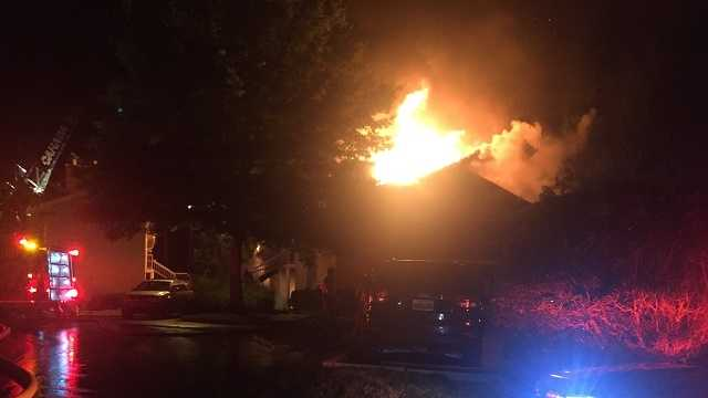 Firefighters battling large apartment fire in Shelby County