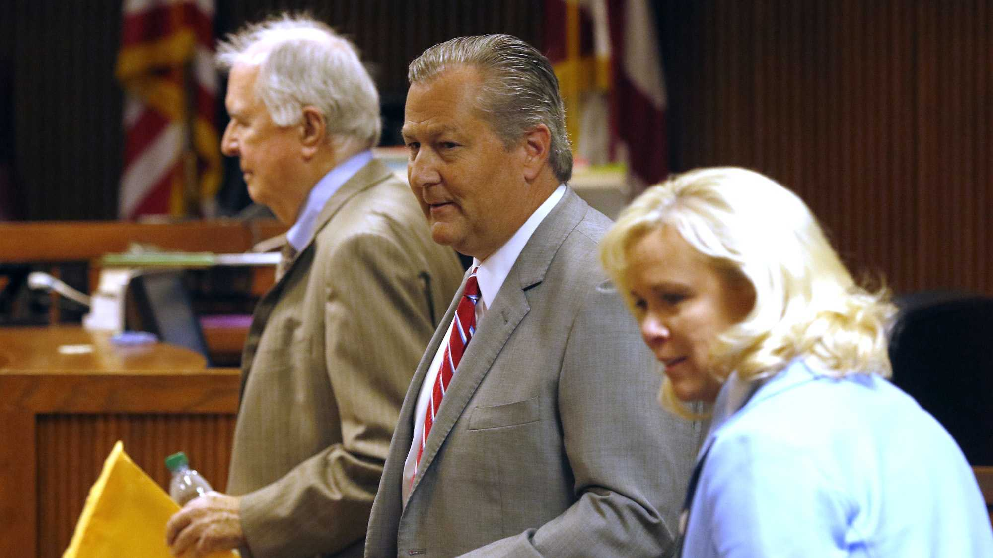 Mike Hubbard enters the courtroom for sentencing on Friday, July 8, 2016, in Opelika, Ala.