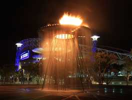 The Summer Olympics have been held twice in Australia. (1956, 2000)Sydney Olympic Park at night with fiery couldren - Adam J.W.C. - Creative Commons Wiki
