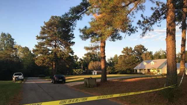 Neighbors discover shooting victim lying in yard.JPG