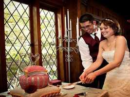 """Castle McCulloch with the candelabra and windows makes this """"Beauty and The Beast"""" Themed Wedding come to life, along with the pillow cake."""