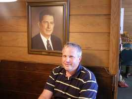 Meet owner Chip Stamey. Pictured above him is his grandfather and the restaurant's founder, Warner Stamey.