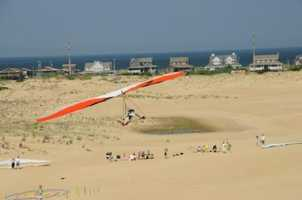 Jockey's Ridge State Park is the tallest active sand dune system in the eastern US. The park's popular activites are kite flying and hanggliding lessons. But wait until you see the breathtaking sunset over the sound!