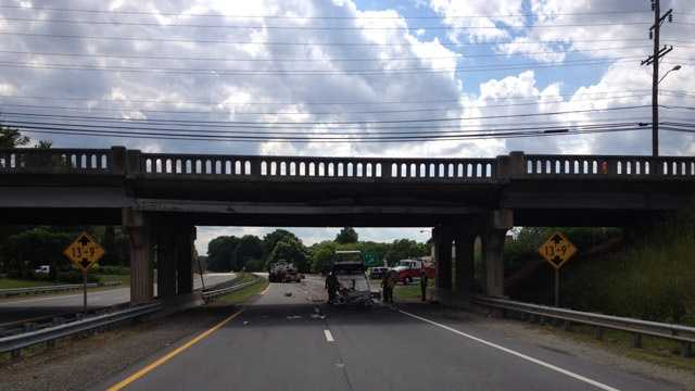 Truck crashes into Business 85 bridge