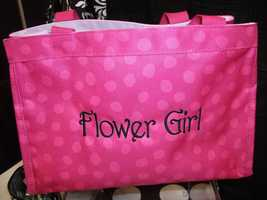 The flower girls bag would be a nice gift and maybe put some dollar store toys, coloring books and/or candy in it to keep her busy before the ceremony...(Thirty-One Personalized Gifts)