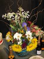 Flowers on the reception tables can be as small or eloquent as you would you like them...(Whole Foods Market)