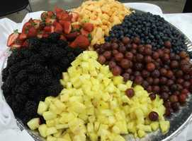 Serving up fresh fruits to add color and great taste to any reception...(Salem Catering)