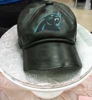 Cake & All Things Yummy even make grooms cake and this nice Carolina Panthers Football hat is pretty cool...