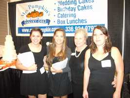 The ladies from Mrs. Pumpkin's had plenty of wedding cakes to show off and taste...