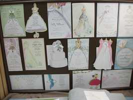 Beautiful whimsical wedding invitations with wedding dresses, cakes and rings could be found at The Carolina Weddings Show...(Invitations Only - A Fine Stationary and Gift Boutique)
