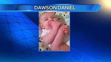 """Dawson is now 5 months old and """"found his toes"""" the other day, Michelle said."""