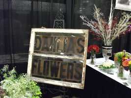 Nice sign for Dahlias Flowers atThe Carolina Weddings Show which could be used for the wedding reception for the couples table.