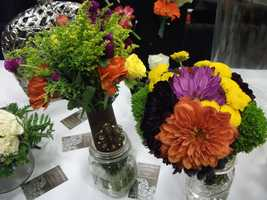 Great fall colors and a neat way to carry them down the aisle in this different style bouquet holders. Something new, something old? (Dahlias Flowers)
