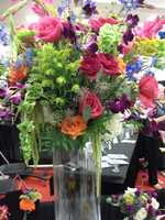 These nice big arrangements are great for the centerpieces or tablescapes on your reception tables. Maybe you just want one of them for the wedding party and to save on the budget, smaller flower arrangements on individual tables. (Dahlias Flowers)