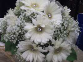 Beautiful flowers withjewelrymake a brides bouquet. (Beverly's of Midway Flowers and Gifts)