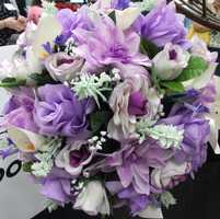 This spring looking bouquet or arrangement would be great for the reception tablescapes. (Bennett's Baskets N Bows)