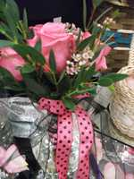 Lots of silver or gold can be used for holiday themed weddings or if those colors are part of your palette for the ceremony. (Bennett's Baskets N Bows)