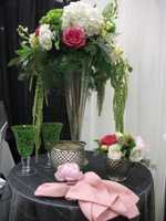 Weddings by Hummingbird Designs had tablescapes that could be used on a single table or several for the reception.