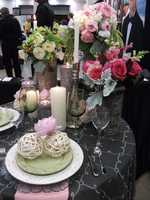 Weddings by Hummingbird Designs had some cool logs that where used as vases. Simple items can be used to decorate the tables at your reception like different size or style candle holders.