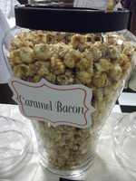 Popcorn bar or just a few flavors would be great for the bachelor party. It can also be served at bachelorette parties, wedding shower and pre-rehearsal dinners. (The Popcorn Fanatic)