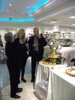 This couple asked questions of Karen's Cake and Candy Decorating business about their cakes and food catering.