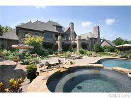 Rear Exterior with swimming pool and pool house