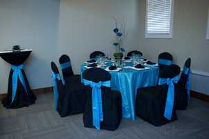 This classic blue and black could be the couples wedding colors decorating the tables for the reception.