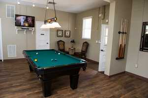 """The WinMock Grooms Den for sports watching and pool table for the groomsmen to play. Great place for the """"Sweet Home Alabama"""" theme and a bachelor/bachelorette party or just to unwind before the wedding."""