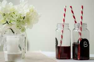 Neat ideas can be found at weddings. These samples of easy mason jars with the bride and grooms initials on them or just something to say what the drink is. Cute straws for decor. These simple candles and flower arrangement are nice too. (WinMock Briadal Show)