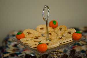 This caterer took into consideration the fall wedding theme with some small pumpkin candies added to this server of cookies. Many small ideas can enter your wedding theme. (WinMock Bridal Show).