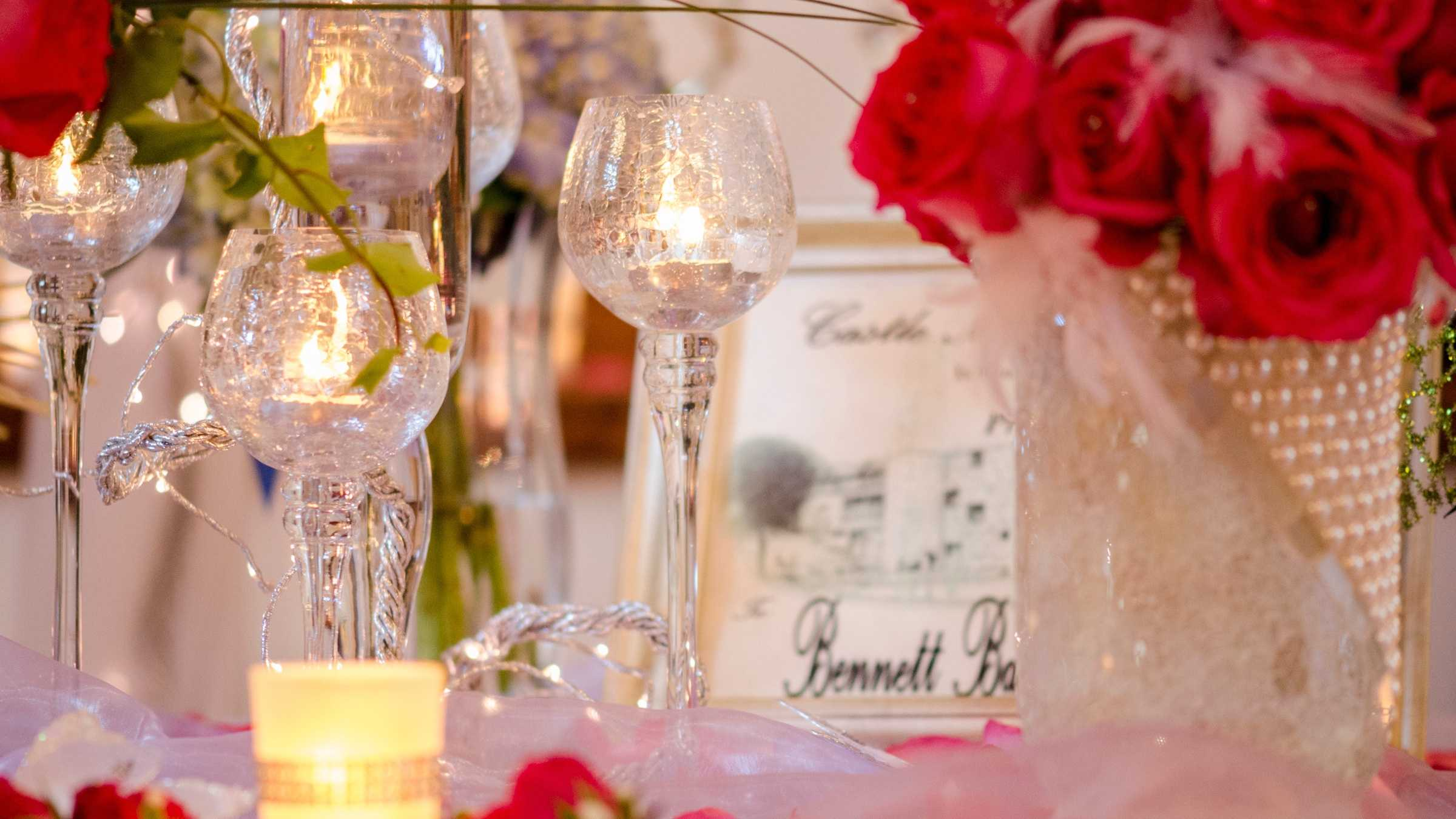 Bennett's Baskets N Bows had some beautiful crystal candle holders and roses that could decorate the reception tables for a Red Carpet Themed Wedding. (WinMock Bridal Show)