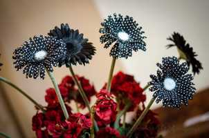 Neat little touches like this flower arrangement with spots could show the fun in the couple at the reception. It won't take a lot of over decorating to show your inspirations or theme. (WinMock Bridal Show)