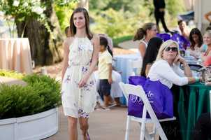 Going up to receive that gift at the end of thePerfect Wedding Guide Triad/Triangle - WinMock Bridal Show.