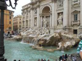 Don't forget to pose for honeymoon pics too at The Trevi Fountain in Trevi district of Rome, Italy.