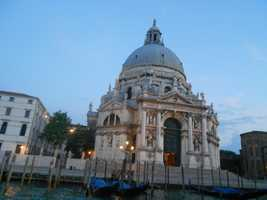 La Salute Church - The Church of Saint Mary of Good Health built in 1630 because of the plague in Venice, Italy can be seen in the Grand Canal. Take a boat ride or Gondola to see this incredible church's architectural works..