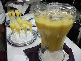 Drinks, punches, mimosas can be served in big glass fountains like this one to bring more color to the reception. (Holiday Inn)
