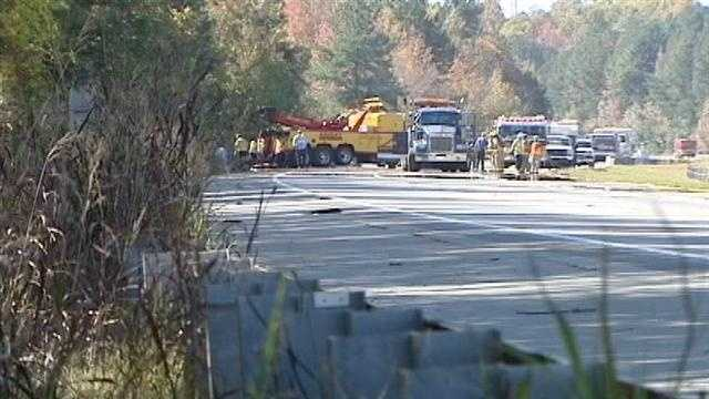 Crews worked to remove a truck carrying explosive material that fell about 20 feet down an embankment on Interstate 85. (Chris Petersen/WXII)