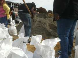 In Baltimore City, residents fill up sand bags.