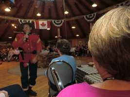 One of the Canadian Mounted Police sings to the tour group at the Beaver Creek Rendezvous show in the Yukon.
