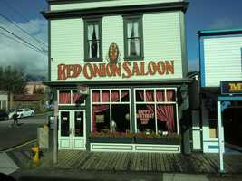 The Red Onion Saloon was opened by William Moore who was also the founder of Skagway in 1898. He wanted to serve the boom towning miners and it still shows the way of the old west even today in Alaska.
