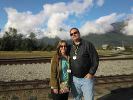 Austin and Angela enjoying their visit in Skagway, Alaska with its beautiful mountain terrain.