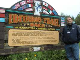Austin stops for a minute in Wasilla, Alaska to get a pic with the Iditarod Trail Sled Dog Race sign and to read about the history of the trail.