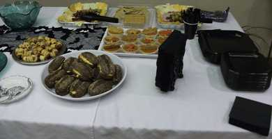 Lots of food with black and orange color palette works well for wedding parties. Finger foods like the pigs in a blanket, pimento cheese sandwiches, meat trays and highly decorated bat and fall leaves pumpkin and apple pies are great to get the wedding group full...(Food and Decorations by Ted Nichols, Jr.)