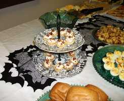 These Halloween decorations work well with a Halloween Themed Wedding. Servings of Hor d'oeuvres, deviled eggs and many other finger foods could help the wedding budget if the couples family and friends help out for the reception. (Food and Decorations by Ted Nichols, Jr.)