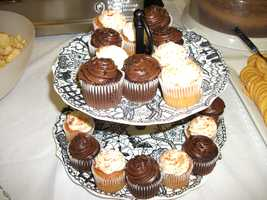 These cupcakes would work great on the dessert bar. Some couples have these for the wedding guests and have a small cake for the cutting ceremony to trim their wedding budget. (Foods and Decorations by Ted Nichols, Jr.)