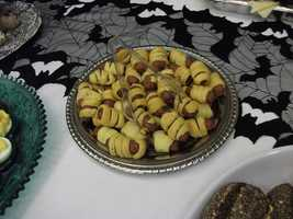 Do It Yourself can help the couple's wedding budget or getting family and friends involved with the reception. Think out of the box like these grand biscuits cut small and spiral around small dogs for a unique pigs in blanket. (Decorations by Ted Nichols, Jr.)