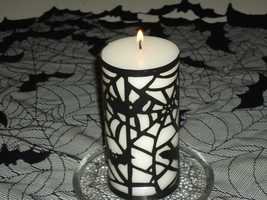 Excellant candle holders can make the ambience of the Halloween Themed Wedding at the reception. (Decorations by Ted Nichols, Jr.)