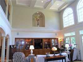 Two-story Living Room with coffered ceiling