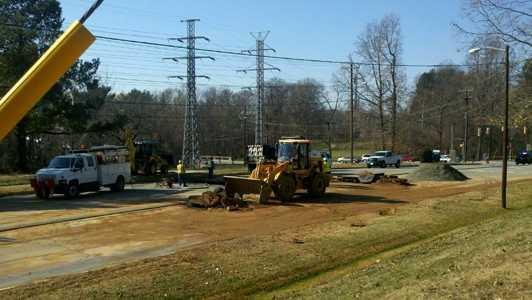 Crews repair a broken water main on Benjamin Parkway. (Rich Cisney/WXII)