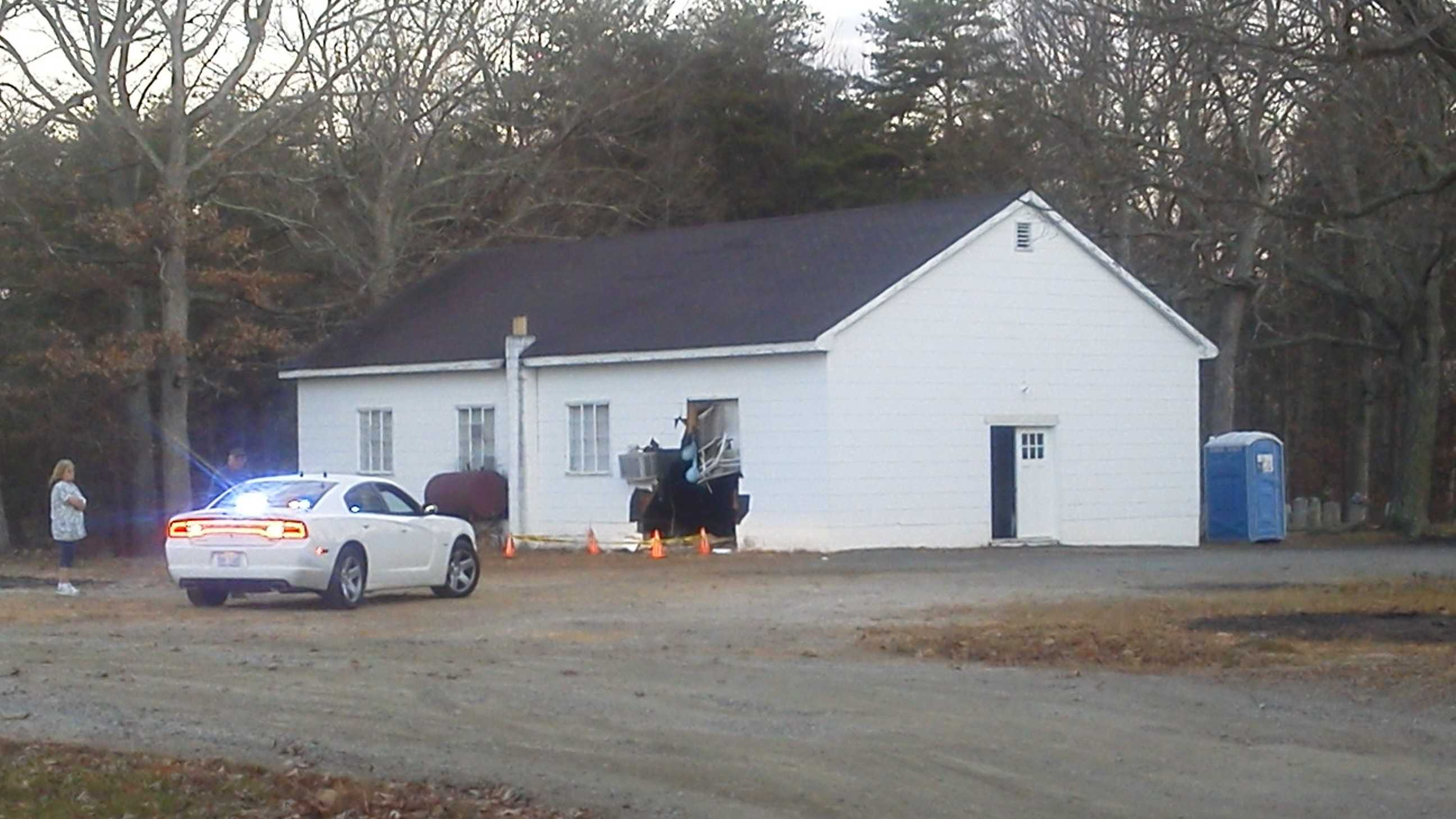 A car plowed into a building on the property of New Hope Baptist Church Tuesday morning. (Joey McDonald/WXII)